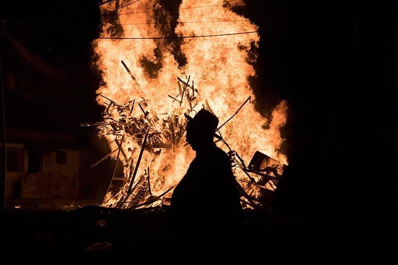 Ultra Orthodox Jews dance around a large bonfire in the neighborhood of Mea Shearim in Jerusalem, Israel (EPA Photo)