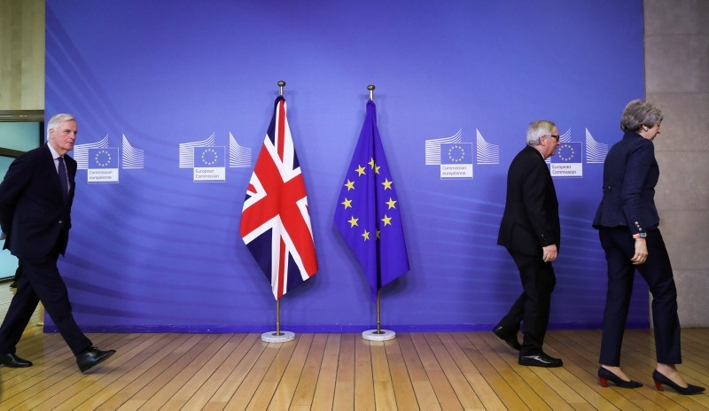 EU Chief Brexit Negotiator Michel Barnier walks behind European Commission President Jean-Claude Juncker and British Prime Minister Theresa May at the European Commission headquarters in Brussels, Belgium February 7, 2019. (Reuters Photo)