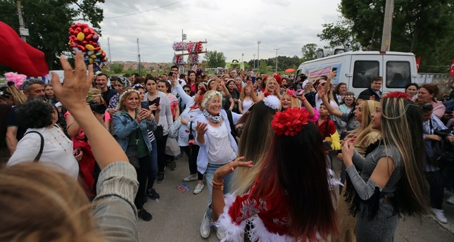 Roma community dances during the Kakava festival, celebrated in May, where they celebrate the coming of spring and Roma culture.