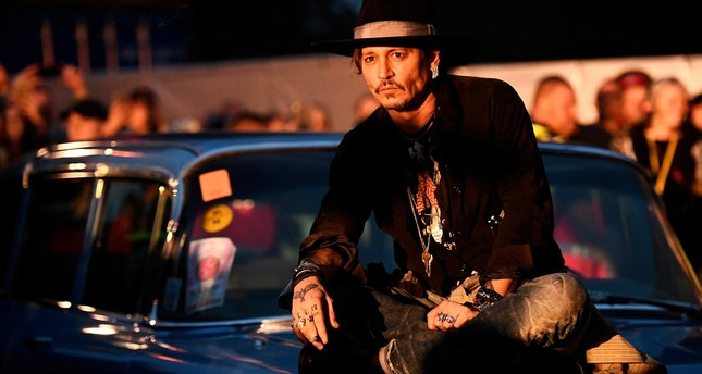 Actor Johnny Depp poses on a Cadillac before presenting his film The Libertine, at Cinemageddon at Worthy Farm in Somerset during the Glastonbury Festival in Britain, June 22, 2017. (REUTERS Photo)