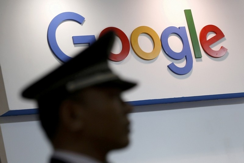 A security guard keeps watch as he walks past a logo of Google in Shanghai, China, April 21, 2016. (Reuters Photo)