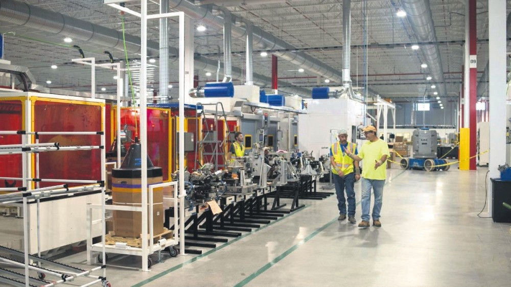 The new Faurecia SA plant in Columbus, where digitalized and robotic production requires high skilled workers.