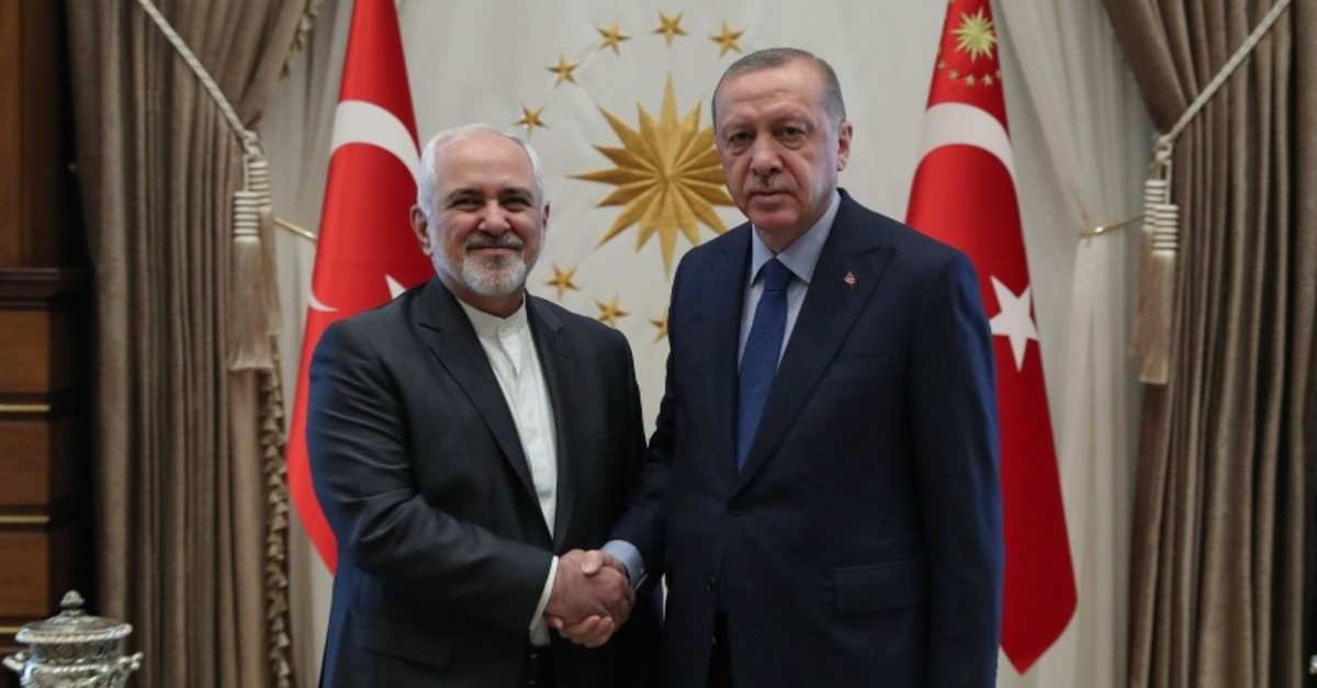 Photo released by the Turkish presidential press service on April 17, 2019, shows President Recep Tayyip Erdou011fan shaking hands with Iranian Foreign Minister Mohammad Javad Zarif (L) in Ankara, Turkey. (AFP Photo)