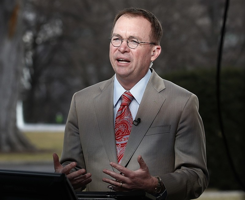 Director of the Office of Management and Budget Mick Mulvaney talking during a television interview outside the White House in Washington (AP Photo)
