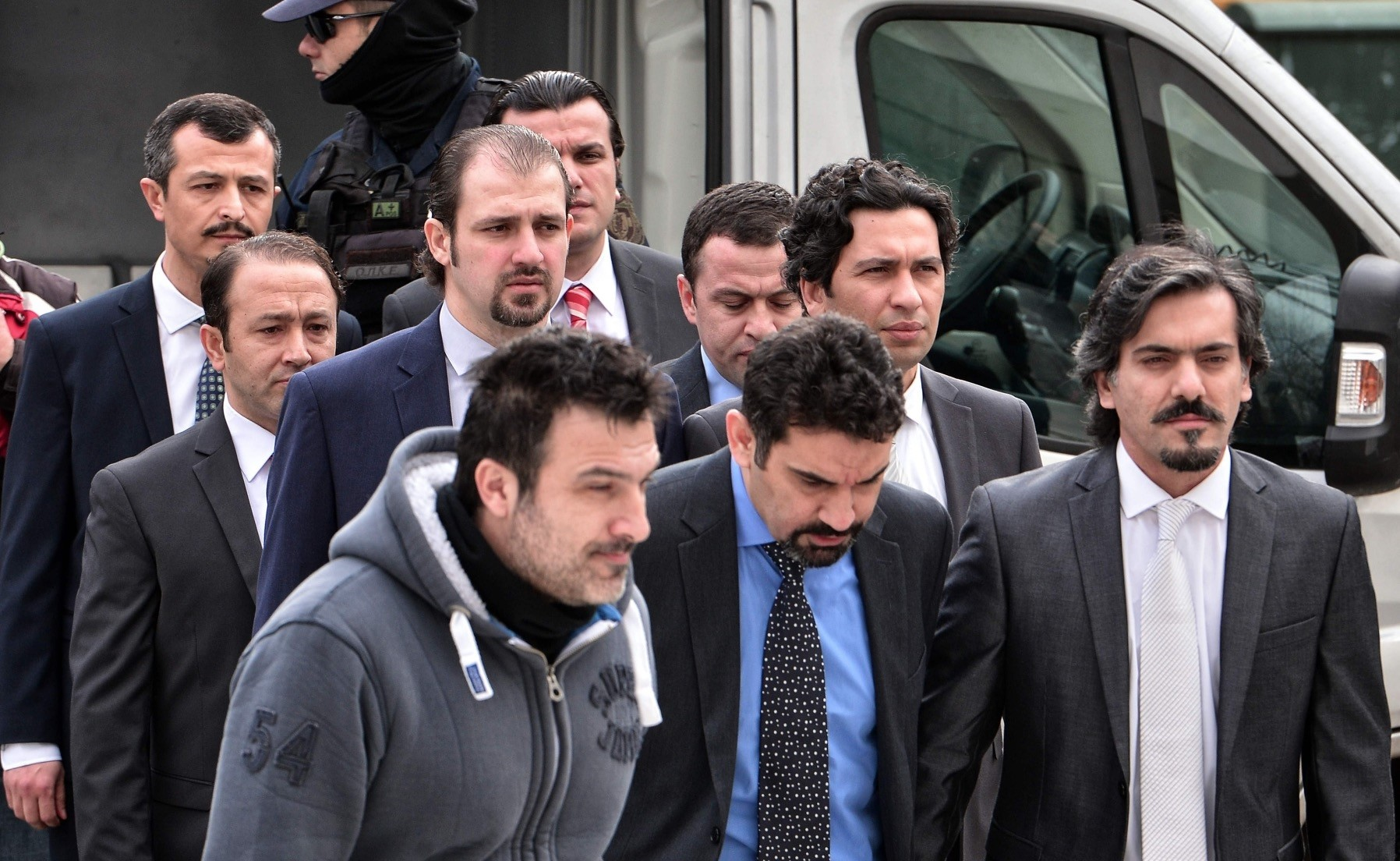 Eight suspected putschists wanted by Turkey are escorted by Greek police as they arrive at a court in Athens in 2017. Greece granted asylum to three among them, to the chagrin of Ankara.