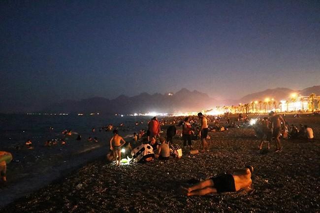 Thousands of people hit the Konyaaltu0131 beach at night as sweltering heat observed across Turkey, Antalya, Turkey, July 2, 2017. (IHA Photo)