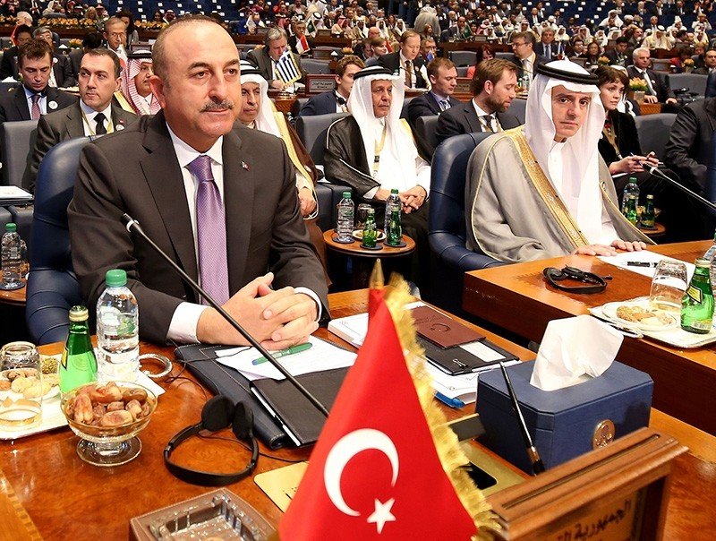 Foreign Minister Mevlu00fct u00c7avuu015fou011flu (L) and then-Saudi Foreign Minister Adel al-Jubeir attend the second day of an international conference for reconstruction of Iraq, in Kuwait City, on Feb. 14, 2018. (AFP Photo)