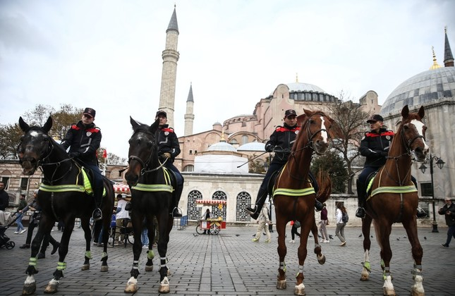 Mounted police pose in front of Hagia Sophia.