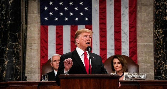 U.S. President Donald Trump delivers the State of the Union address, alongside Vice President Mike Pence and Speaker of the House Nancy Pelosi, at the US Capitol in Washington, DC, on February 5, 2019. (AFP Photo)