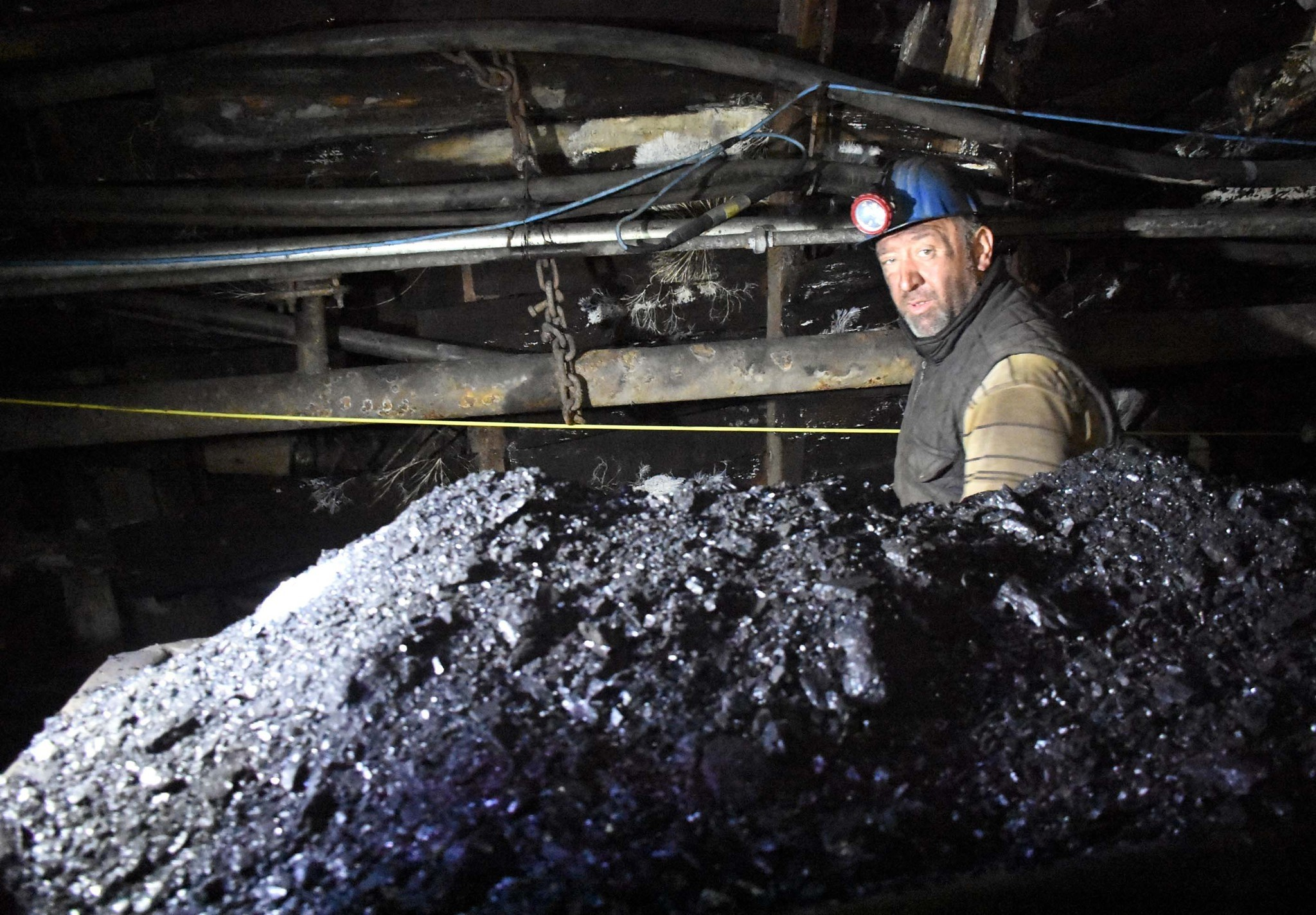 Miner Uu011fur Kandemirou011flu, 44, loads the mined coal into a cart for distribution. Kandemirou011flu, father of one, has been working in the coal mines of Zonguldak for the last 12 years.