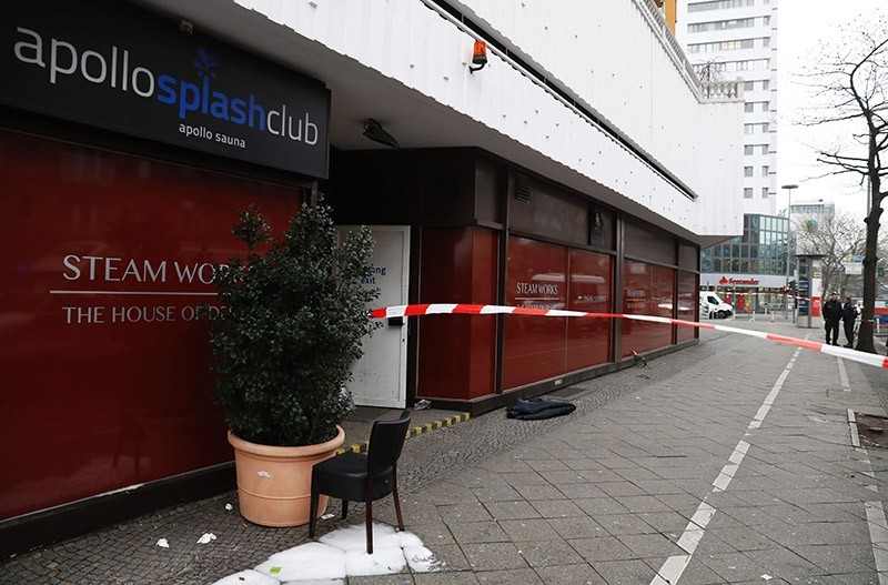Barrier tape cordons off the area in front of a sauna club in Berlin on Feb. 6, 2017, where three men died in a fire the night before. (AFP Photo)
