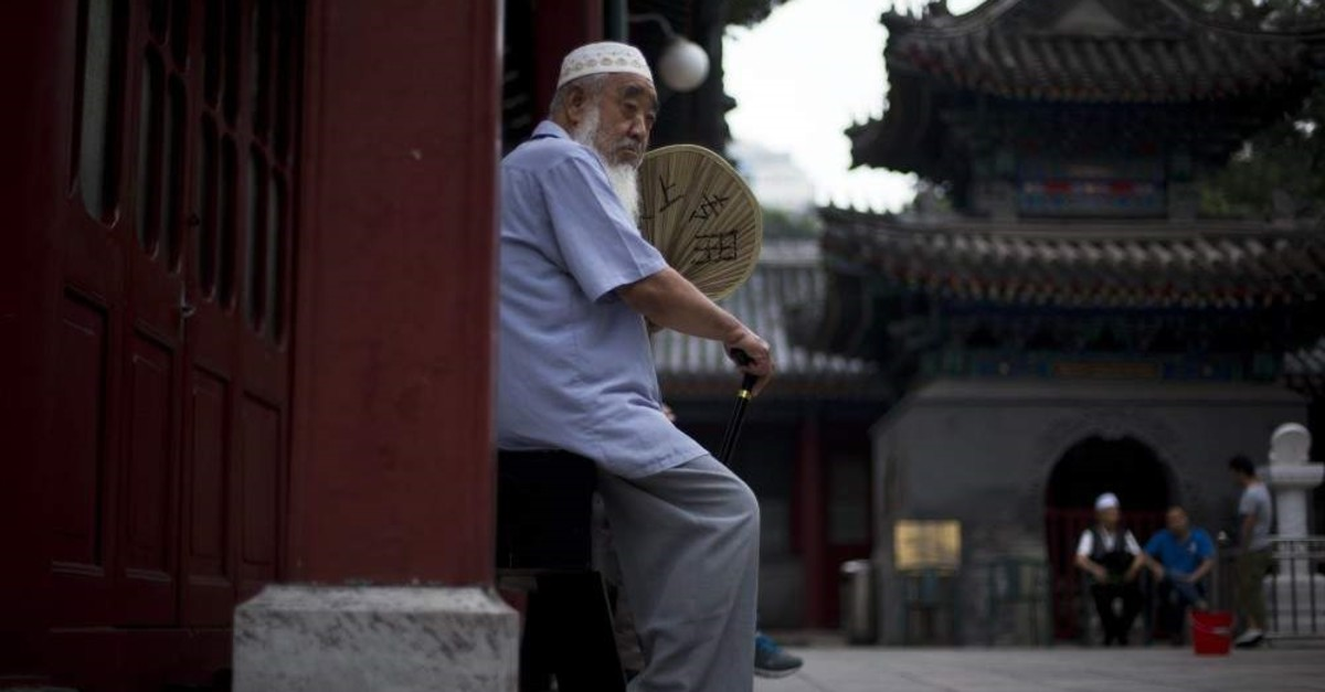 A Chinese Muslim man waits for the time to break his fast during the Muslim holy month of Ramadan at the Niujie mosque, the oldest and largest mosque in Beijing, China, July 2, 2014. (AP Photo)