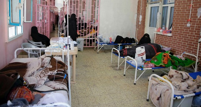 Yemenis are treated for suspected cholera infections at Al-Sabeen hospital, Sanaa, March 30, 2019.