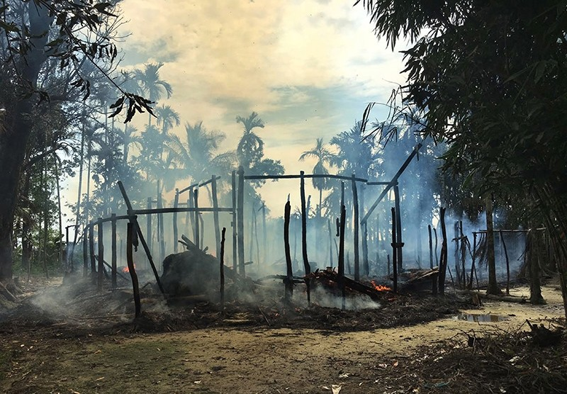 In this Sept. 7, 2017 file photo, smoke rises from a burned house in Gawdu Zara village, northern Rakhine state, Myanmar. (AP Photo)