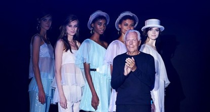 pItalian labels Versus Versace and Emporio Armani brought the darkness and light to London Fashion Week on Sunday, burnishing the city's reputation as a fashion capital./p