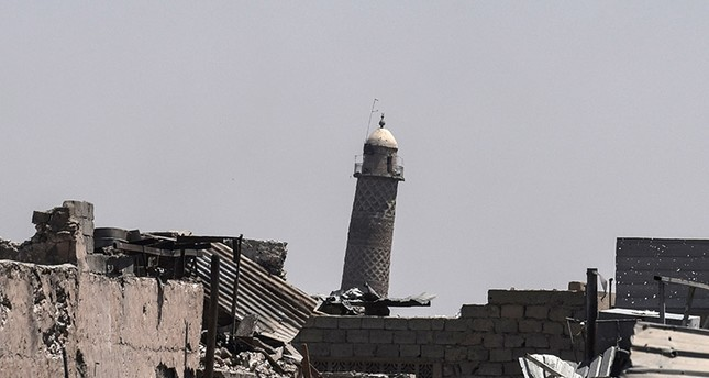 A picture taken on June 19, 2017 shows the leaning Al-Hadba minaret, which is part of the al-Nuri mosque as the Iraqi forces advance towards the Old City on June 19 (AFP Photo)