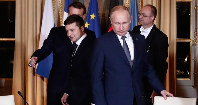 Russian President Vladimir Putin, right, and Ukrainian President Volodymyr Zelenskiy arrive for a working session at the Elysee Palace Monday, Dec. 9, 2019 in Paris. AP Photo