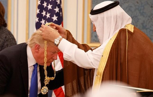 In this May 20, 2017 file photo, Saudi King Salman presents U.S. President Donald Trump with the highest civilian honor, the Collar of Abdulaziz Al Saud, at the Royal Court Palace, in Riyadh, Saudi Arabia. (AP Photo)