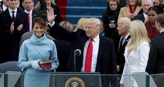 President Trump waves after he is sworn into office on the West Front of the U.S. Capitol on January 20, 2017 in Washington, DC. (AFP Photo)