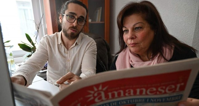 Karen Sarhon R, the editor of the El Amaneser monthly, published entirely in Judeo-Spanish, works on a new edition of the newspaper, Istanbul, Dec. 12, 2019. AFP Photo