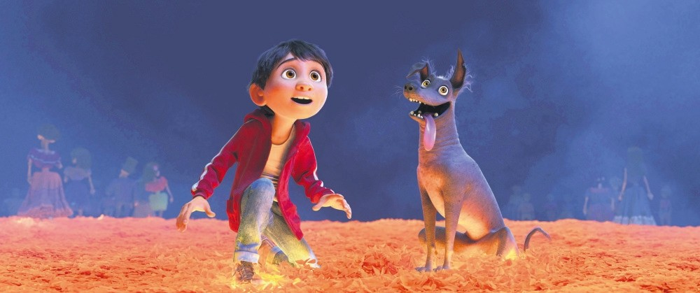 Disney-Pixar characters Miguel, voiced by Anthony Gonzalez, left, and Dante in a scene from the animated film, ,Coco,, one of the largest U.S. productions ever to feature an almost entirely Latino cast.