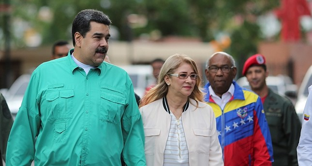 Venezuela's President Nicolas Maduro attends an event to hand over residences built under a government housing programme, with his wife Cilia Flores, in Caracas, Venezuela Nov. 15, 2018. (Reuters Photo)