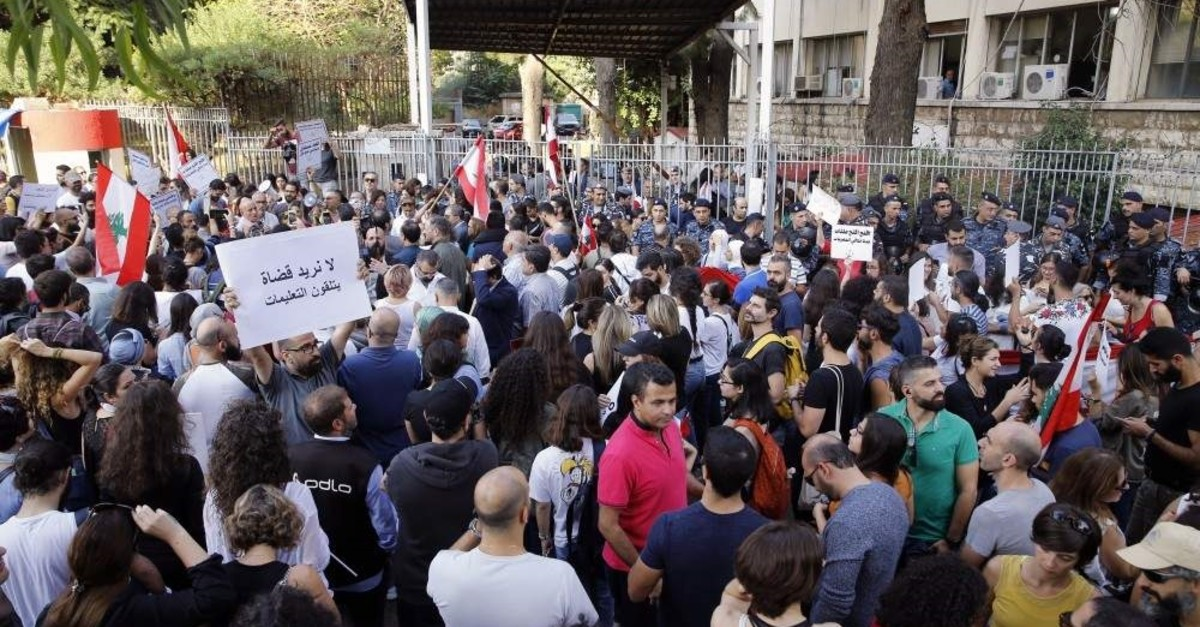Anti-government protesters gather outside the Justice Palace, Beirut, Nov. 6, 2019. (AP Photo)