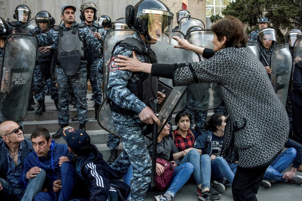 A demonstrator tries to stop riot police officer during an anti-government rally, Yerevan, April 19.