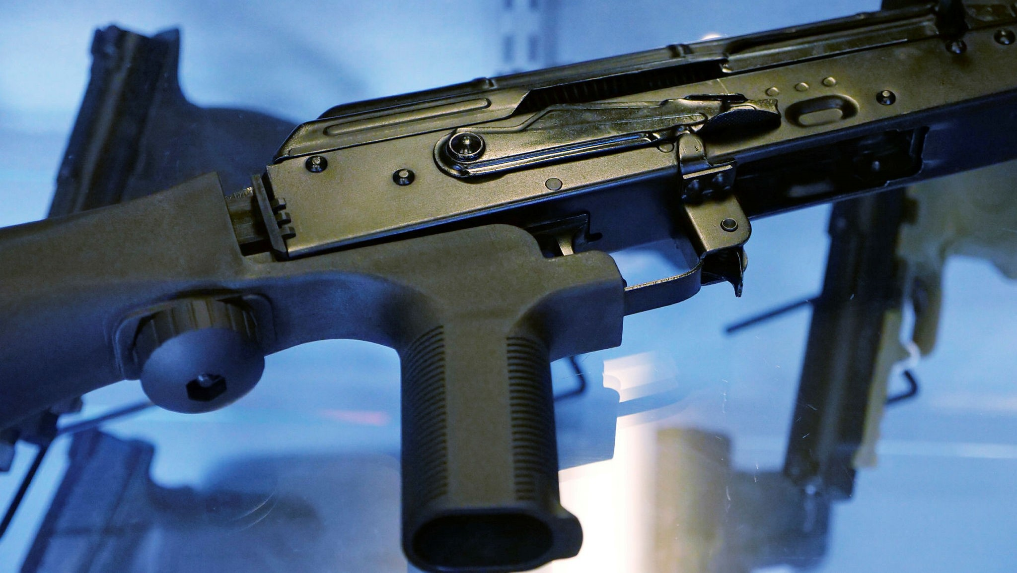 In this Oct. 4, 2017, file photo, a device called a ,bump stock, is attached to a semi-automatic rifle at the Gun Vault store and shooting range in South Jordan, Utah. (AP Photo)