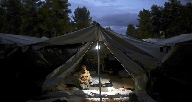 A Syrian man sits inside a tent at the Ritsona refugee camp north of Athens, which hosts about 600 refugees and migrants on Thursday, Sept. 22, 2016. (AP Photo)