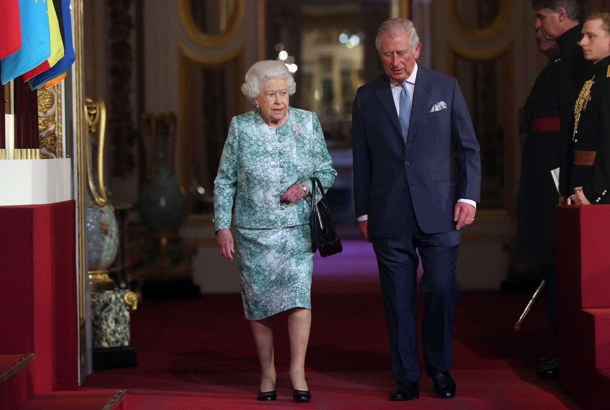 Britain's Queen Elizabeth II and Britain's Prince Charles arrive for the formal opening of the Commonwealth Heads of Government Meeting (CHOGM), in the ballroom at Buckingham Palace in London on April 19, 2018. (AFP Photo)