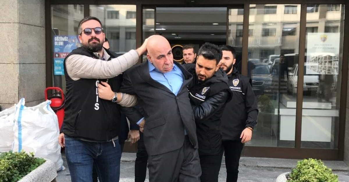 Police officers accompany Ayvaz Korkmaz as he is taken to a courthouse, Istanbul, Nov. 24, 2019. (AA Photo)