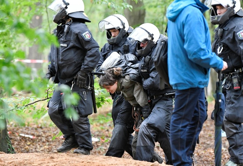 Police arrests activists after removing them from treehouses in the forest 'Hambacher Forst' near Dueren, Germany, Thursday, Sept. 13, 2018. (AP Photo)