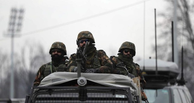 Indian army soldiers guard on top of their armored vehicle as a convoy of New Delhi-based diplomats passes through Srinagar, Indian controlled Kashmir, Thursday, Jan. 9, 2020. AP Photo