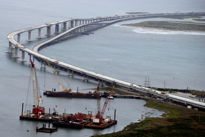 In this Sept. 15, 2018, file photo construction barges are tucked in a protected area around the Bonner bridge across Oregon Inlet, on Hatteras Island, N.C. (AP Photo)