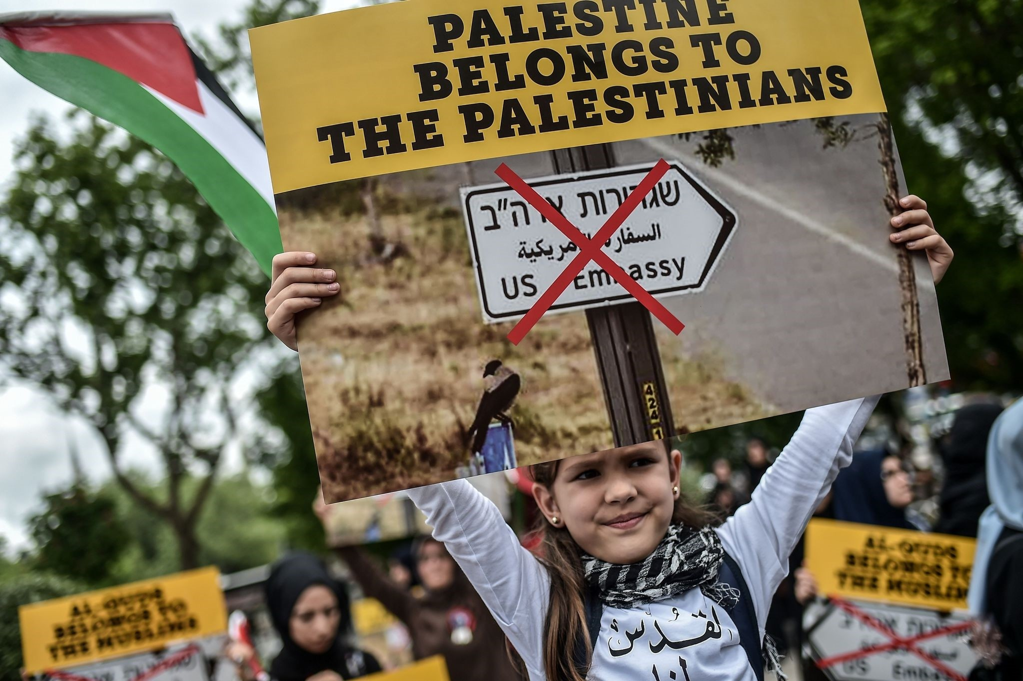 A young girl holds a placard reading ,Al Quds belongs to Muslims, during a demonstration against the opening of a U.S. embassy in Jerusalem, Istanbul, May 11.