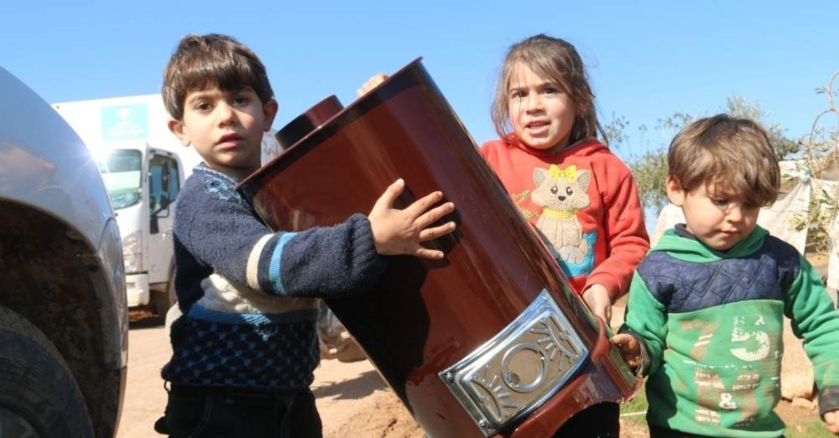 The Turkish charity group distributes heating stoves to Syrian refugees in northern Syria's Azaz region. (Turkiye Diyanet Foundation TDV - AA)