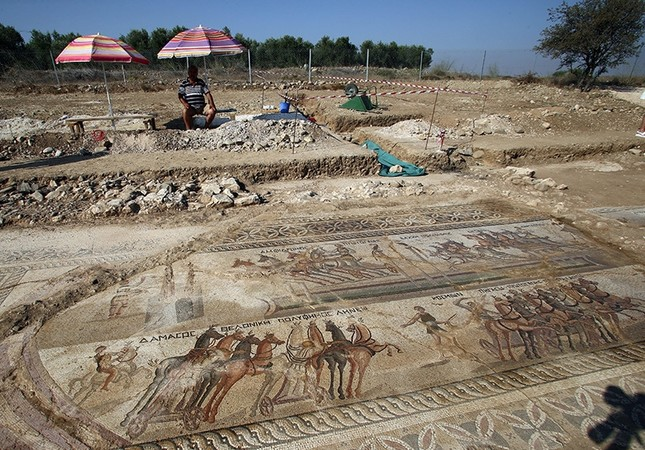 A general view of mosaic floor which depicts a chariot scene taking place in the hippodrome at the Piadhia locality in Akaki village, Nicosia district, Greek Cyprus, August 09, 2016. (EPA Photo)