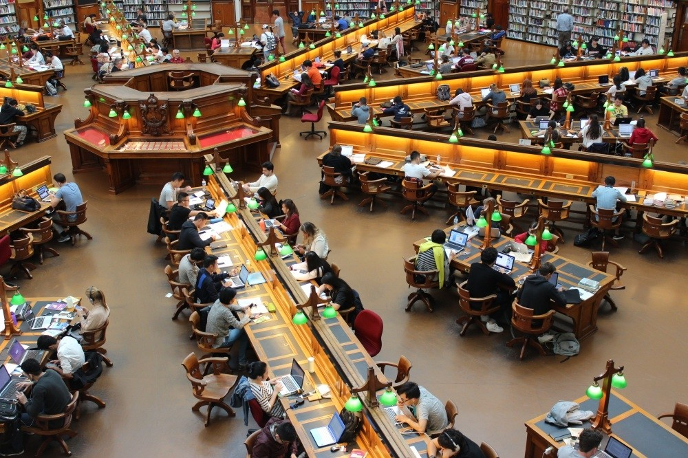Students studying at a university library.