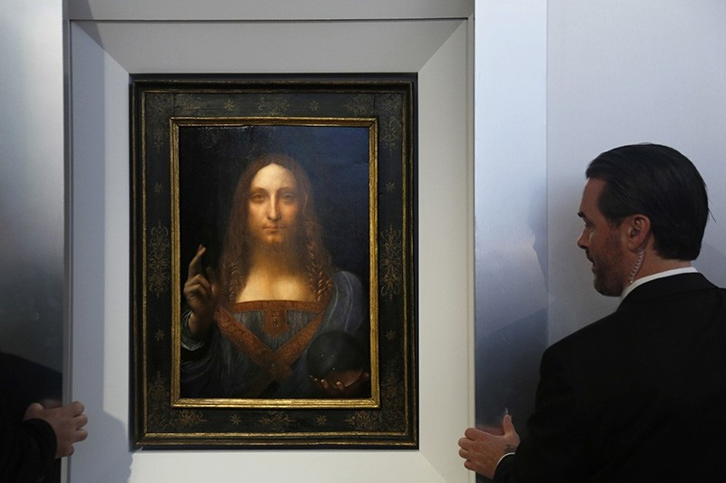 Security guards open a door to reveal ,Salvator Mundi, by Leonardo da Vinci during a news conference at Christie's in New York, Tuesday, Oct. 10, 2017. (AP Photo)