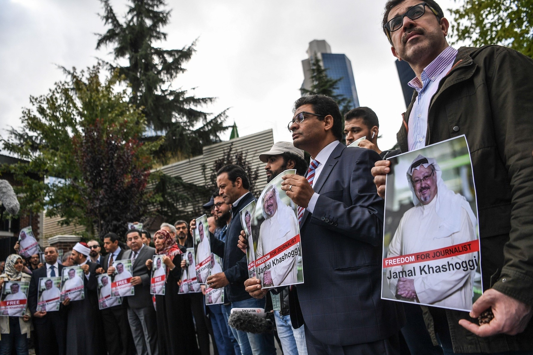 Protesters hold pictures of Jamal Khashoggi during a demonstration in front of the Saudi Consulate in Istanbul, Oct. 8.
