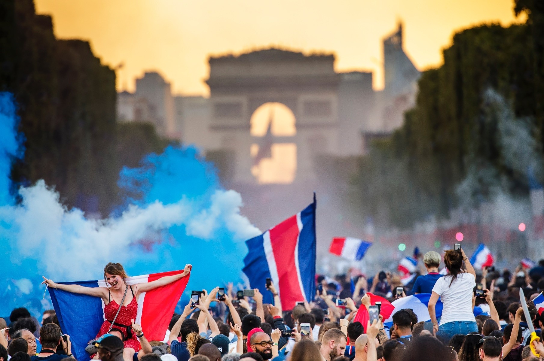French  supporters celebrate their teamu2019s victory on the Champs Elysees.