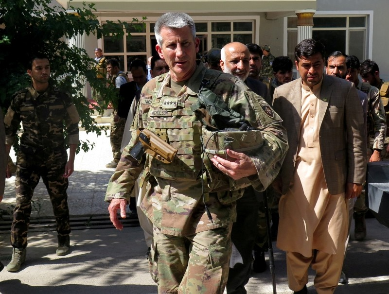 U.S. Army General John Nicholson, commander of Resolute Support forces and U.S. forces in Afghanistan, walks with Afghan officials during an official visit in Farah province, Afghanistan May 19, 2018. (Reuters Photo)