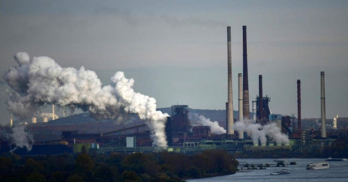 A picture taken on November 11, 2019 shows steam rising from the coking plant at the ThyssenKrupp steel production in Duisburg. (AFP Photo)