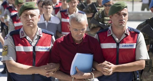 Gendarmerie officers escort Mehmet Dişli to court.