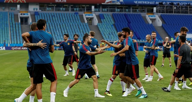 Spain's players take part during Spain's official training on the eve of the group B match between Portugal and Spain at the 2018 soccer World Cup in the Fisht Stadium in Sochi, Russia, Thursday, June 14, 2018. (AP Photo)