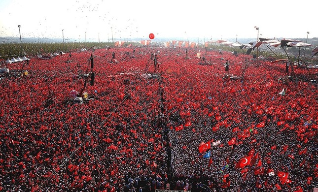 People wave Turkish flags and picture of Turkish President Recep Tayyip Erdoğan during a rally to protest the failed coup attempt on 15 July 2016. (IHA Photo)