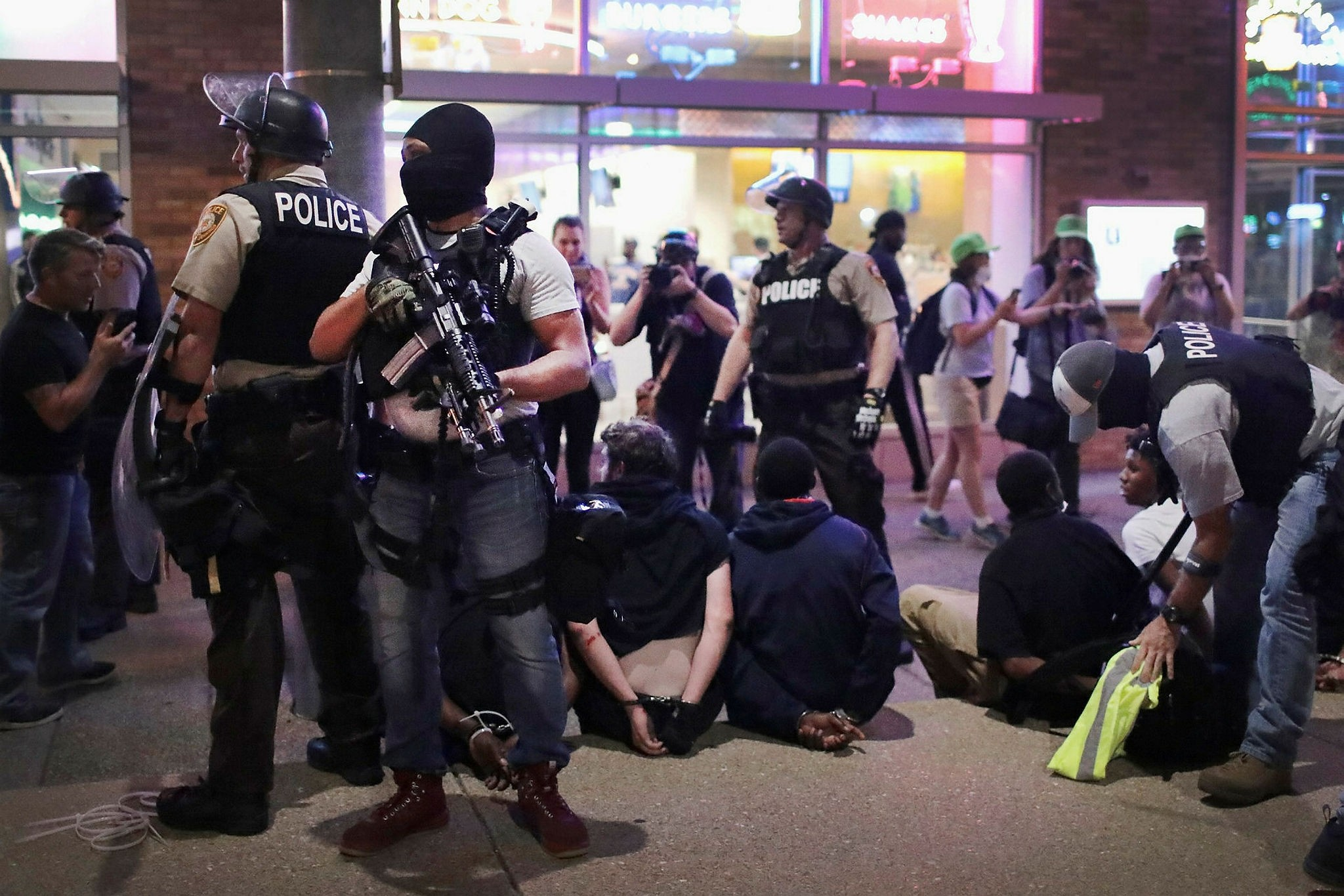 Police arrest demonstrators protesting the acquittal of former St. Louis police officer in Missouri on Sept. 16.