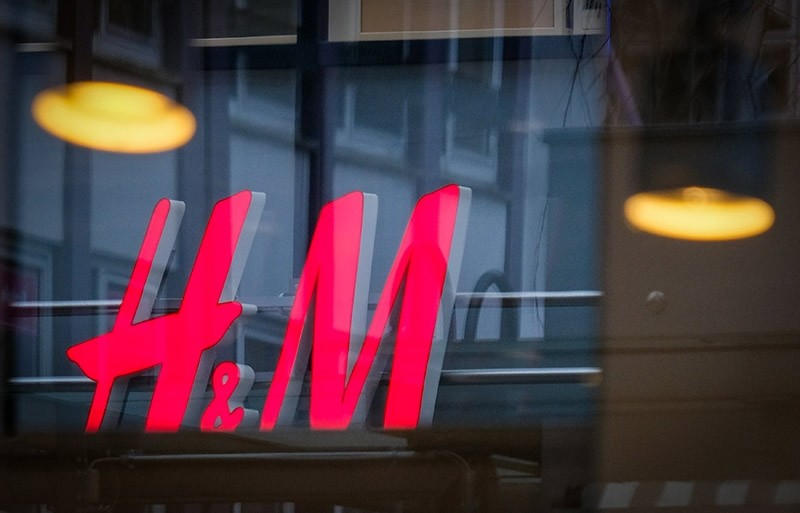 A logo of Swedish clothing company ,H&M,  (Hennes & Mauritz) is seen on a store in the city center of Bremen, northern Germany, 15 January 2018. (EPA Photo)