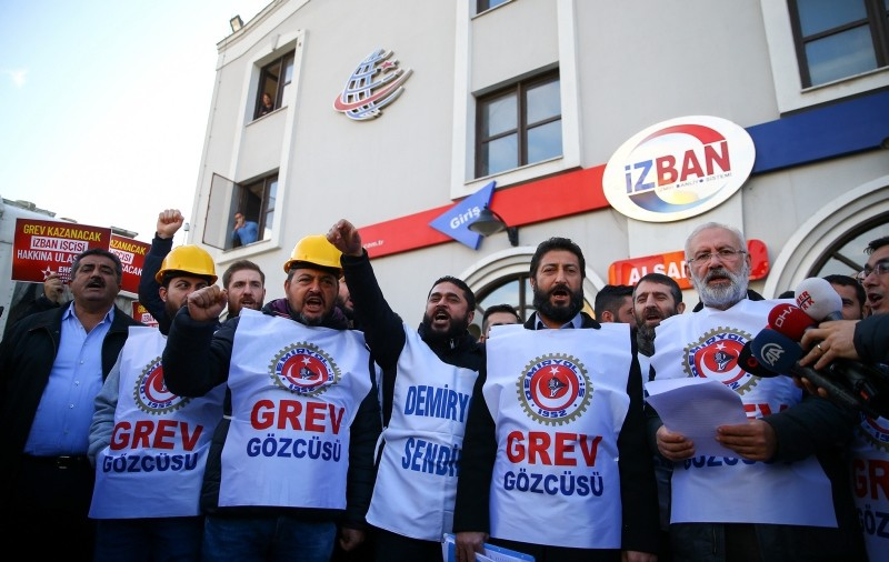 IZBAN workers give a public press statement in from of the Alsancak Train Station, in central Izmir, western Turkey, Dec. 10, 2018. (AA Photo)